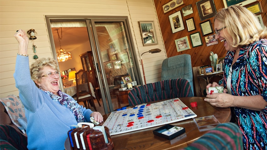 Lois playing bridge with her daughter, Linda.