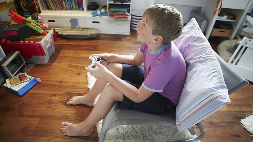 A young boy playing video games