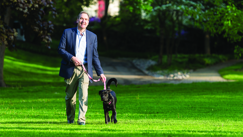 Eric Barth walking his dog after recovering from a drug-induced liver injury from Z-Paks