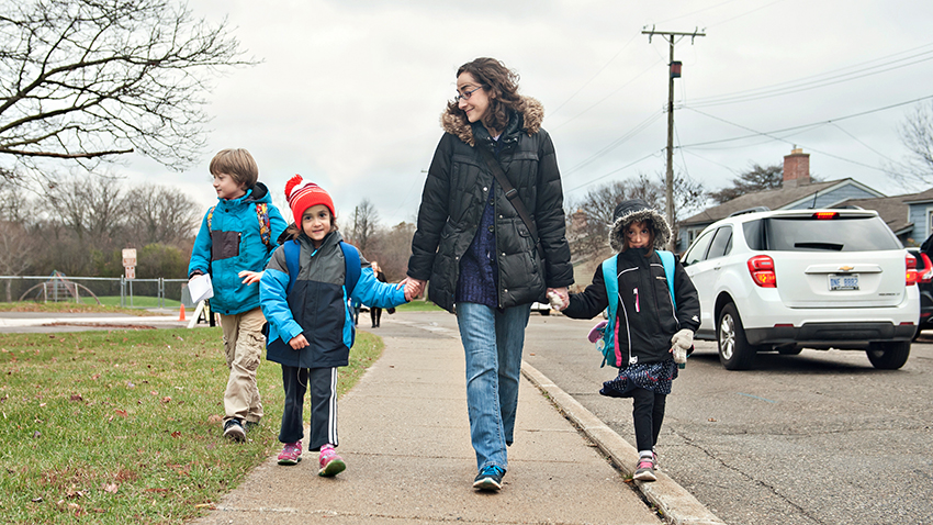 Tori and her three children walking to school