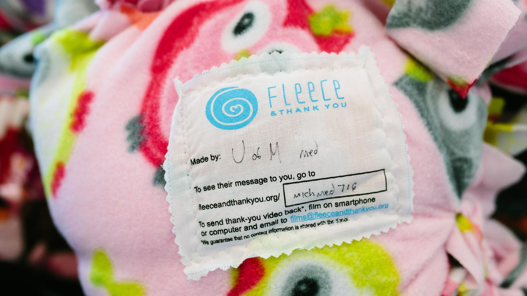 A personalized fleece blanket tag from Fleece & Thank You