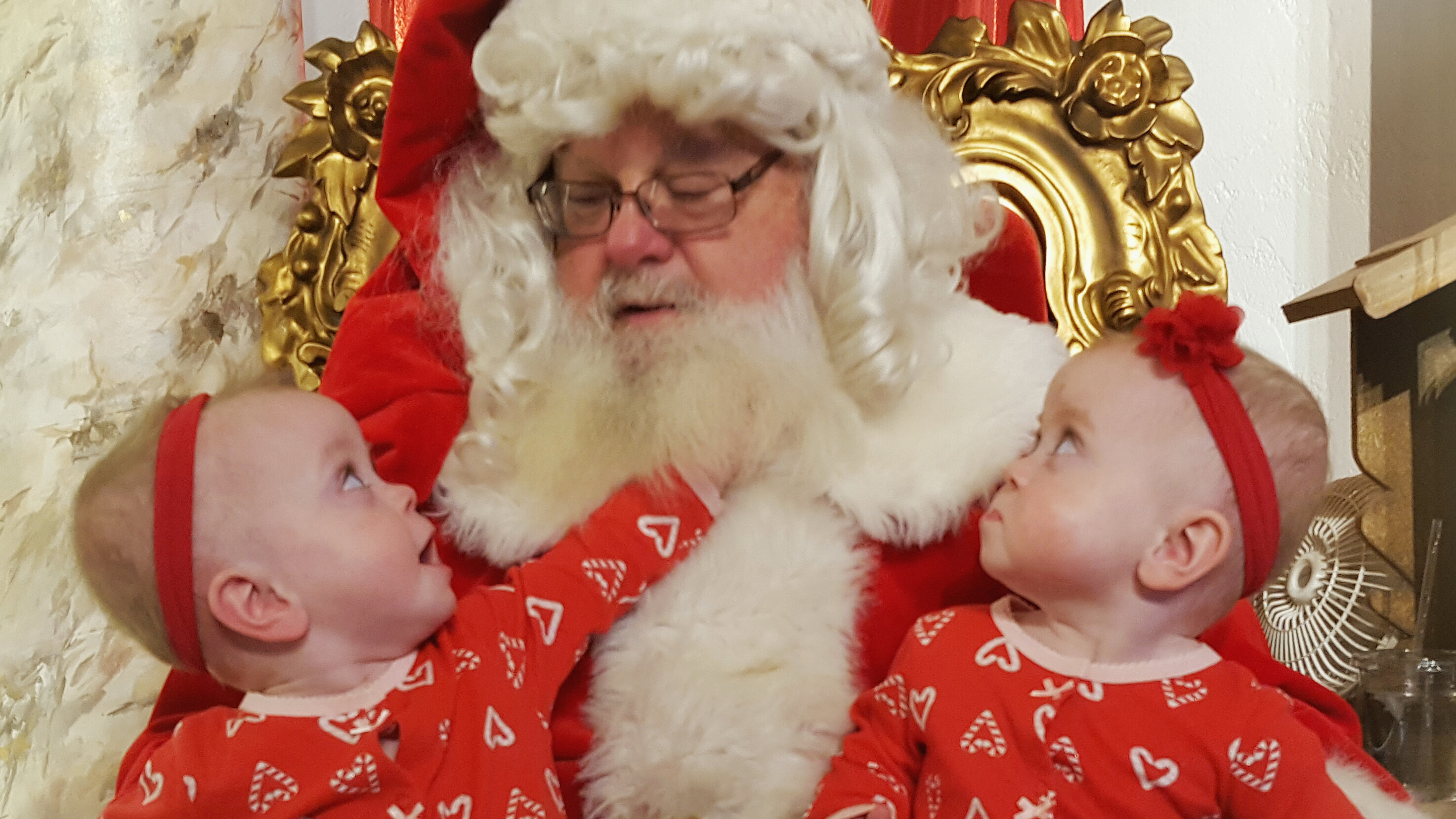 Twin girls on Santa's lap after surviving twin to twin transfusion syndrome