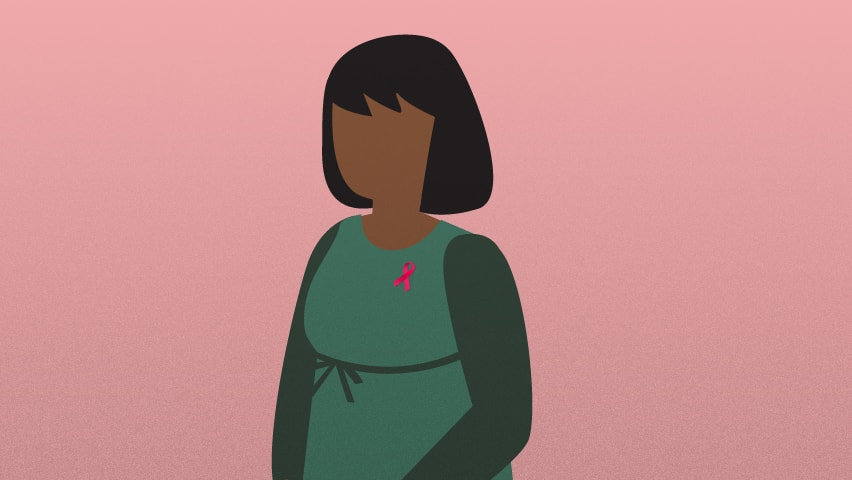 Image of woman wearing green infront of pink background wearing breast cancer pin
