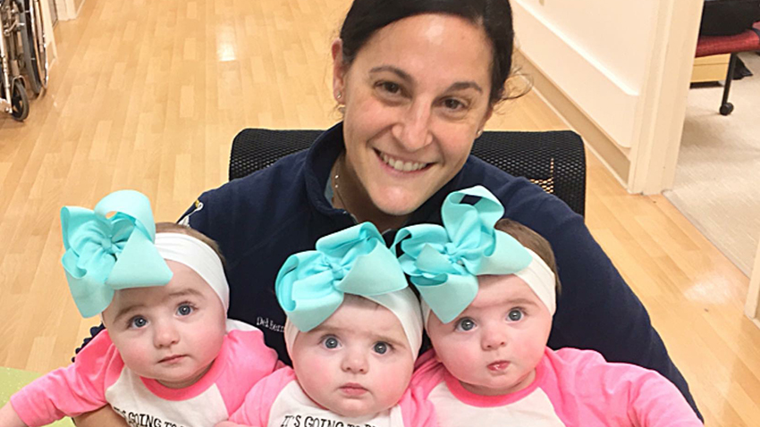 after high risk birth and health scares young triplets thriving