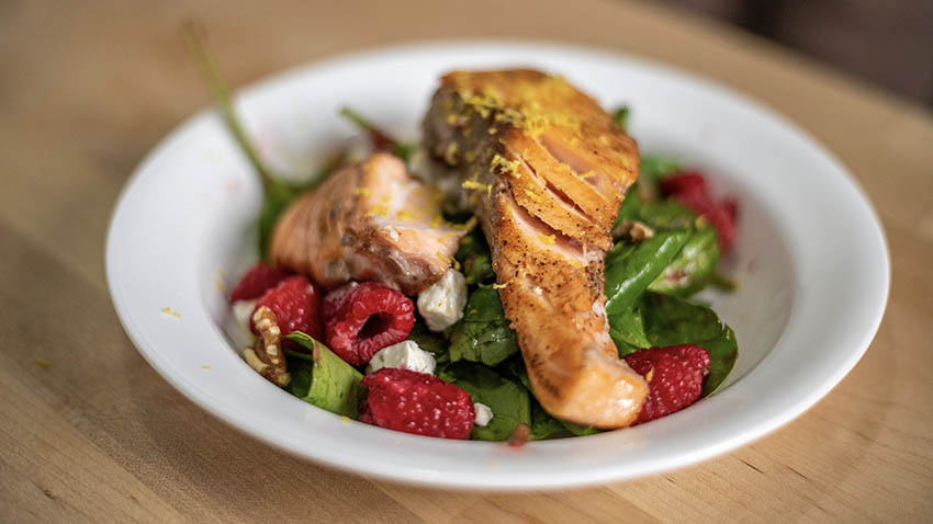 Grilled salmon salad with a raspberry dressing.