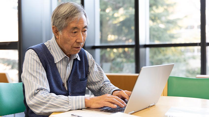 Older gentleman on computer