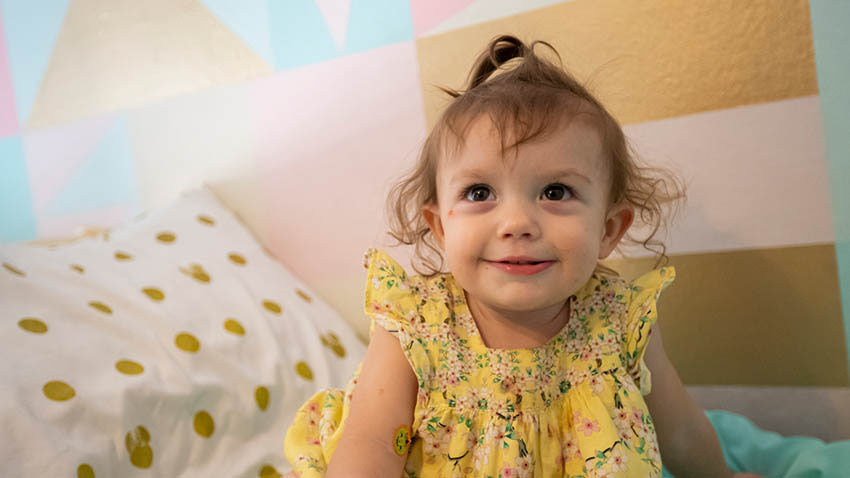Little girl on bed smiling