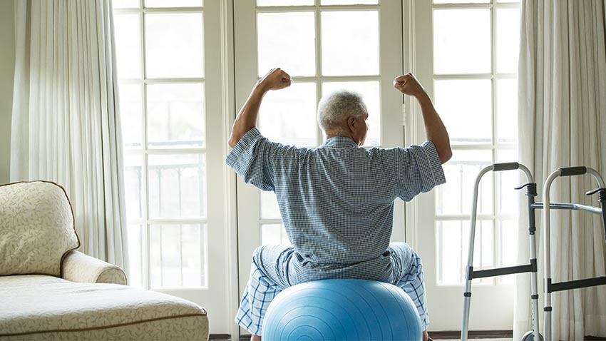 Elderly man working out at home