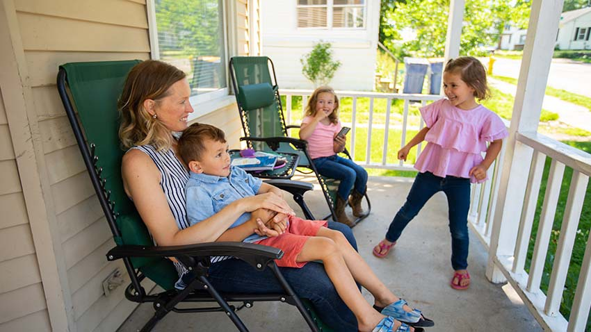 mom and children on front porch playing
