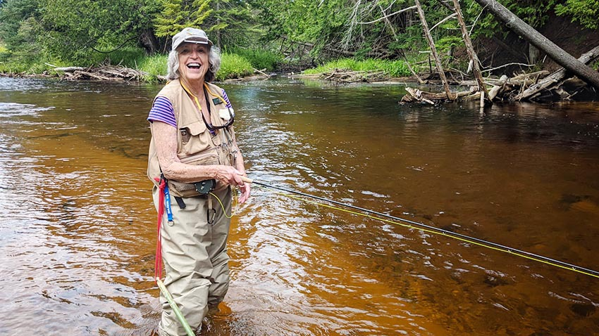 Carol fly fishing on the Maple River.