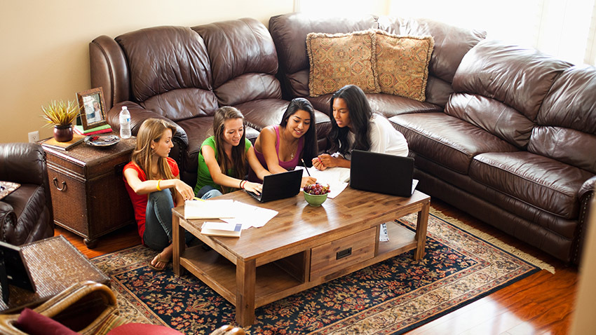 teenage girls studying in pod in family room