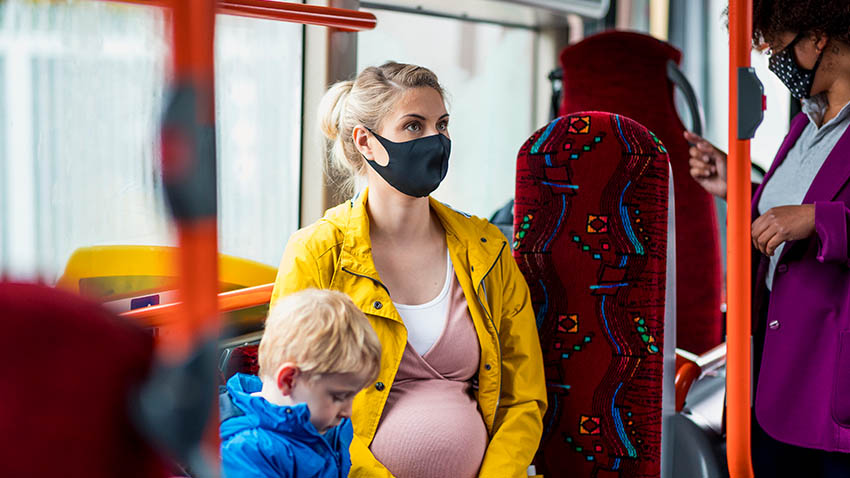 pregnant woman on bus with child