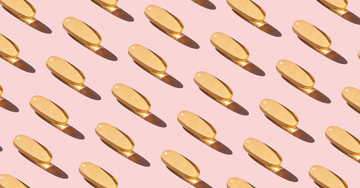 Fish oil pills on pink background