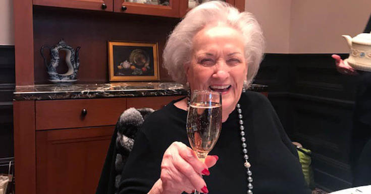 Women cheers with champagne glass