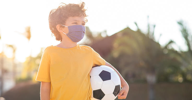 child soccer ball yellow shirt with mask