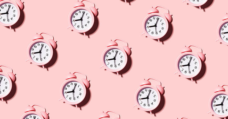 pink old school alarm clock in repetitive pattern