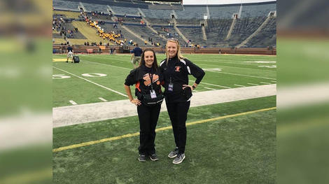 two females on the field at michigan big house